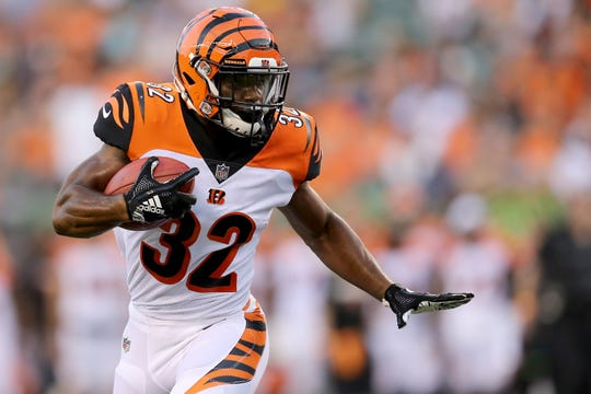 Cincinnati Bengals running back Mark Walton (32) carries the ball in the second quarter during the Week 1 NFL preseason game between the Chicago Bears and the Cincinnati Bengals, Thursday, Aug. 9, 2018, at Paul Brown Stadium in Cincinnati.