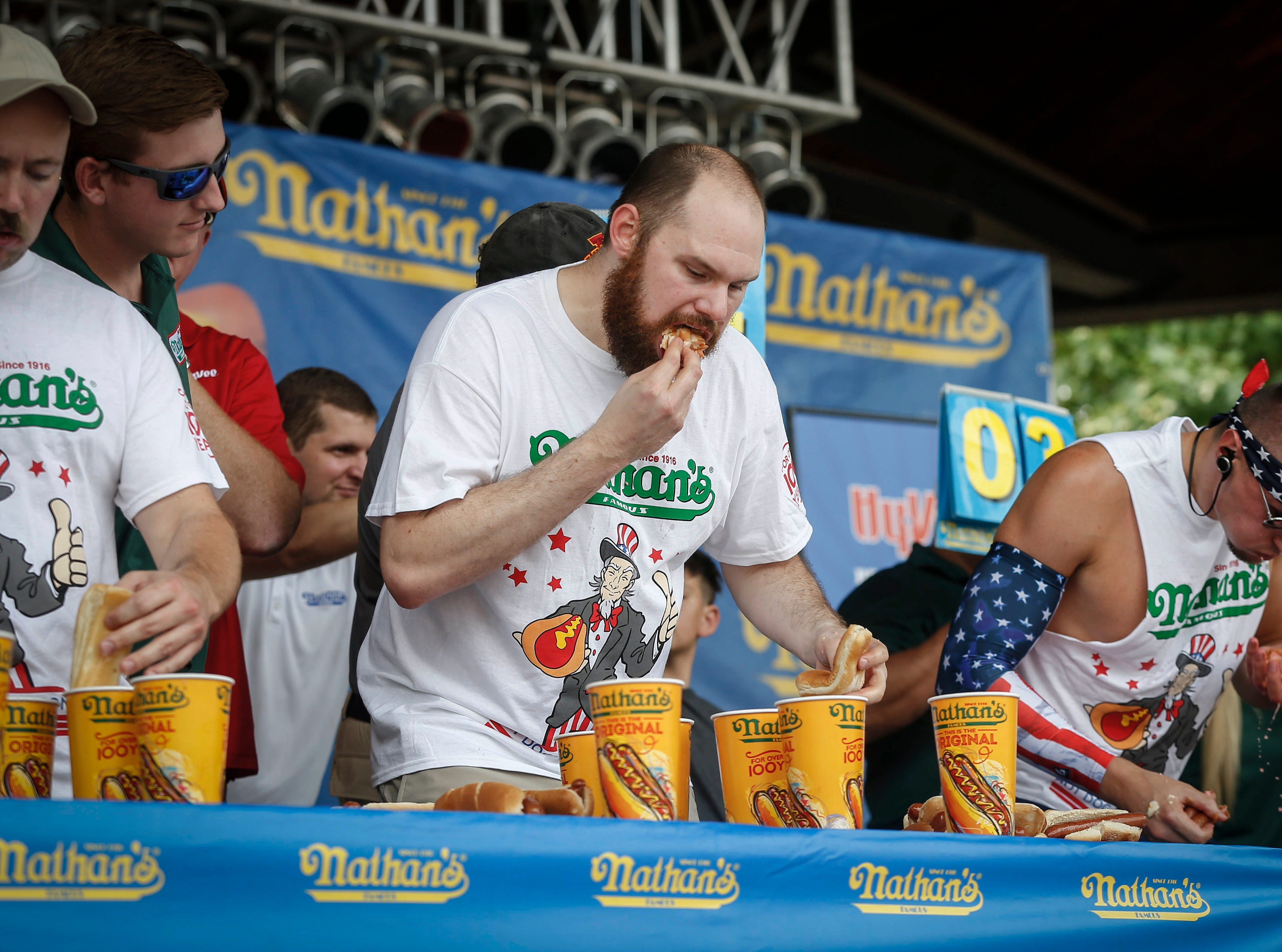 Jake Thompson, last year's defending champion, downs a hot dog during the regional Nathan's Hot Dog eating contest on Saturday, Aug. 11, 2018, during the Iowa State Fair in Des Moines.