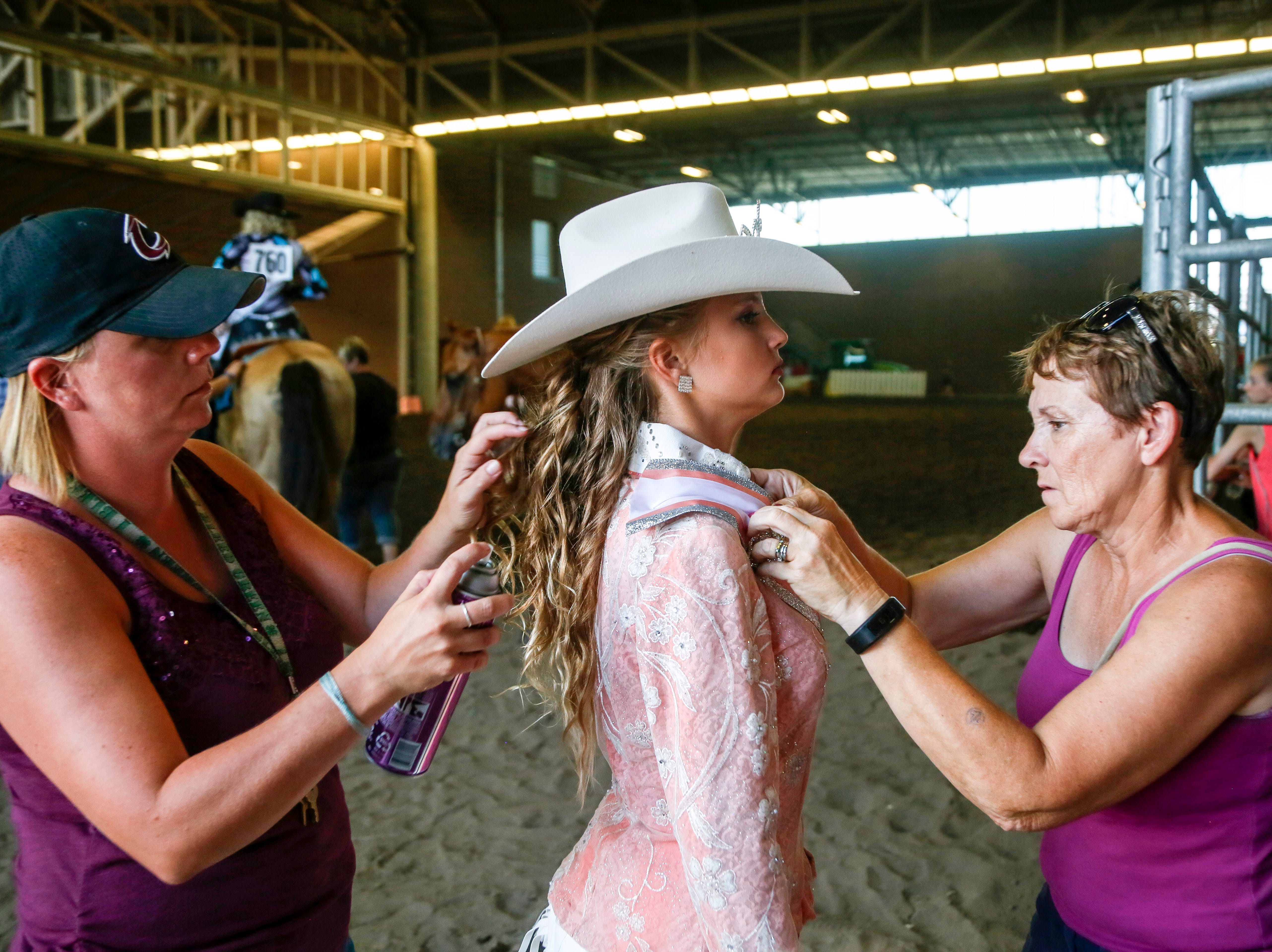 Dana Halsband, 12, of Osceola gets ready before the Cowgirl Queen Contest at the Iowa State Fair Friday, Aug. 10, 2018.
