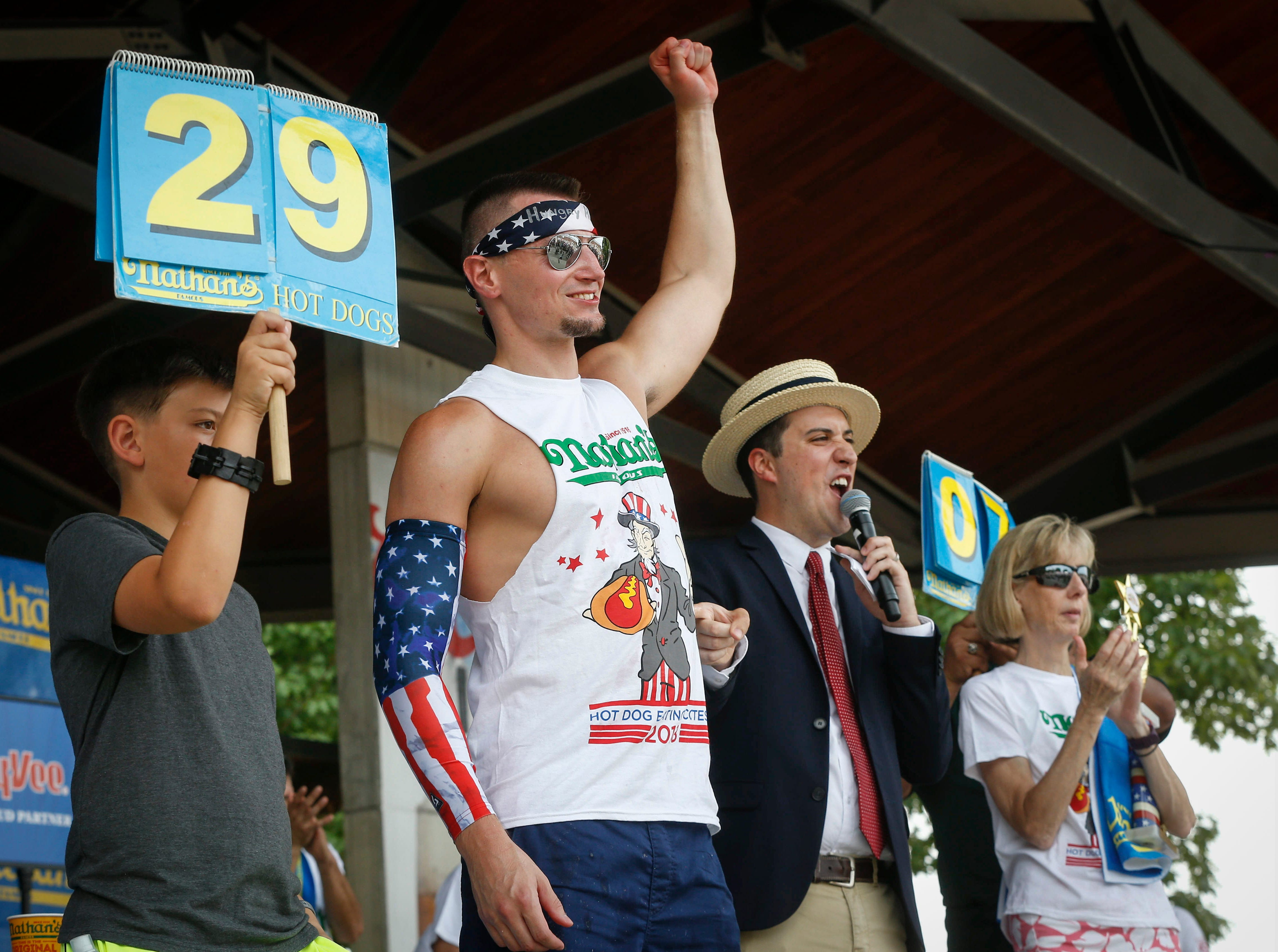"""Matt """"Hungry"""" Hazzard of Normal, Ill., won the Nathan's Hot Dog eating contest in Des Moines after downing 29 dogs on Saturday, Aug. 11, 2018, during the Iowa State Fair in Des Moines."""