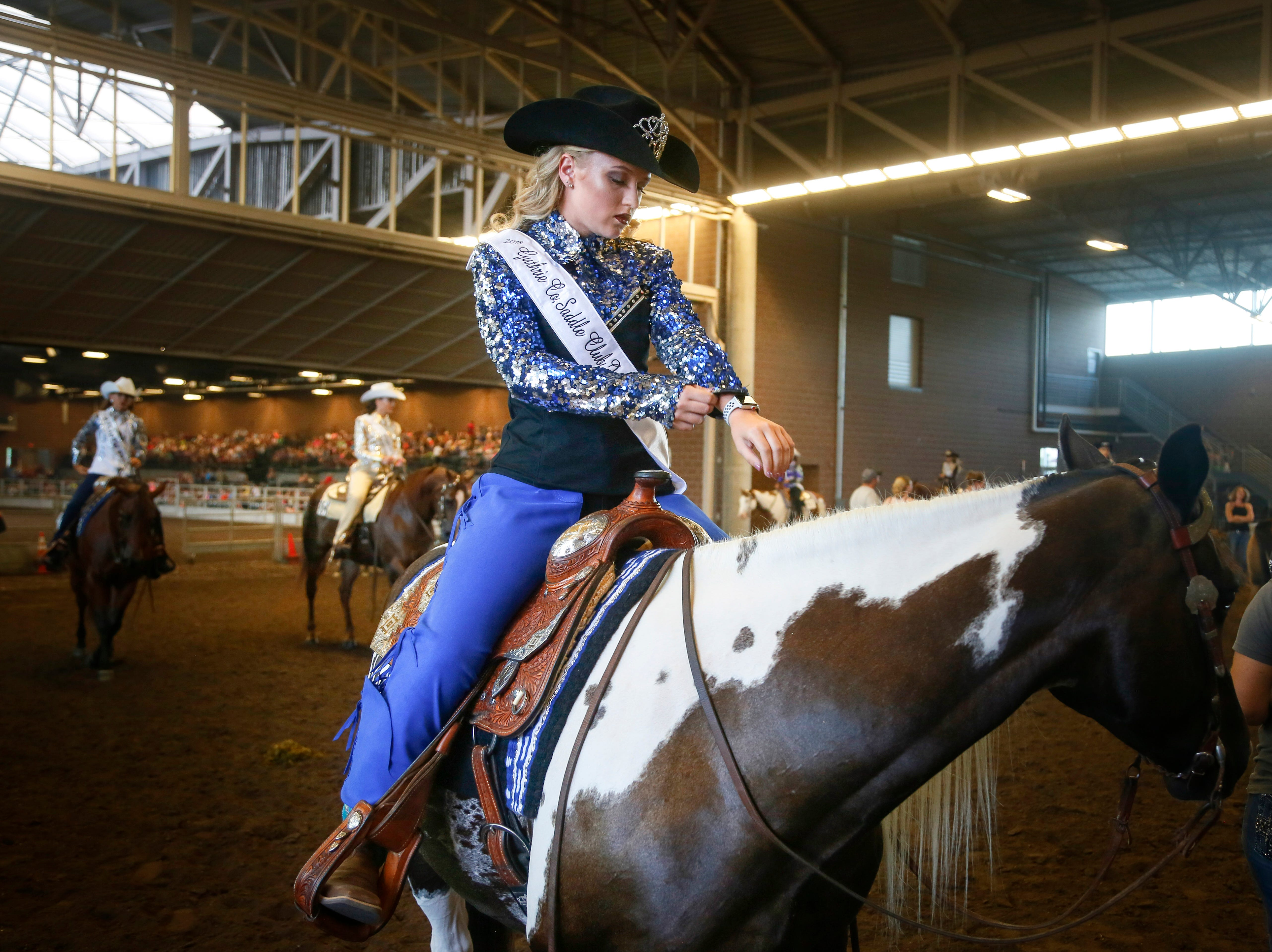 Lillian Berger of Grimes gets ready before the Cowgirl Queen Contest at the Iowa State Fair Friday, Aug. 10, 2018.