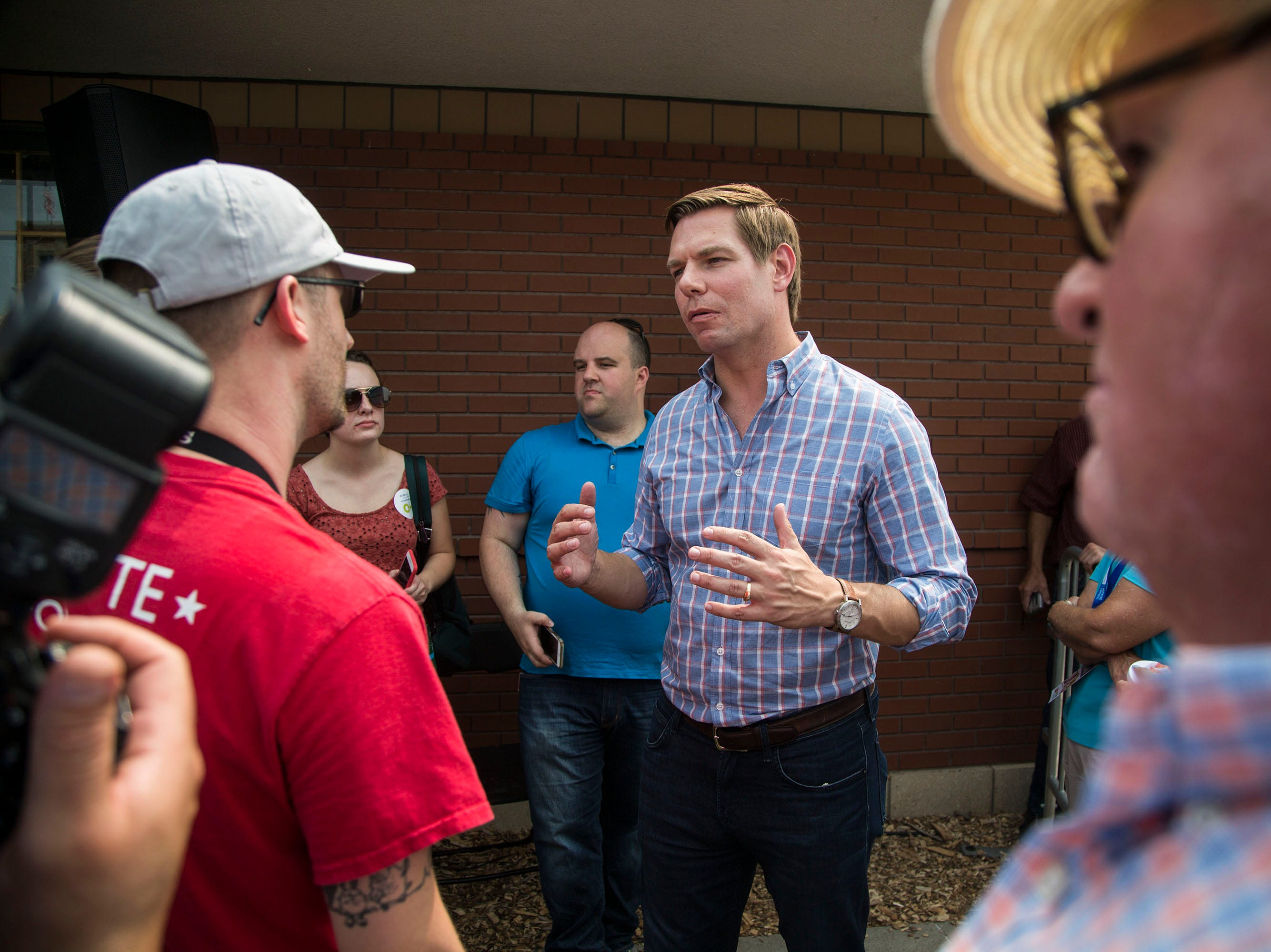 Rep. Eric Swalwell, a Democrat from California, talks with people in the crowd after speaking on the Des Moines Register Political Soapbox, on Saturday, Aug. 11, 2018, at the Iowa State Fair.