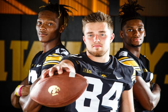 Iowa's Brandon	Smith, left, Nick Easley, center, and Ihmir	Smith-Marsette, right, pose for a photo during the Iowa Football media day on Friday, Aug. 10, 2018 in Iowa City.