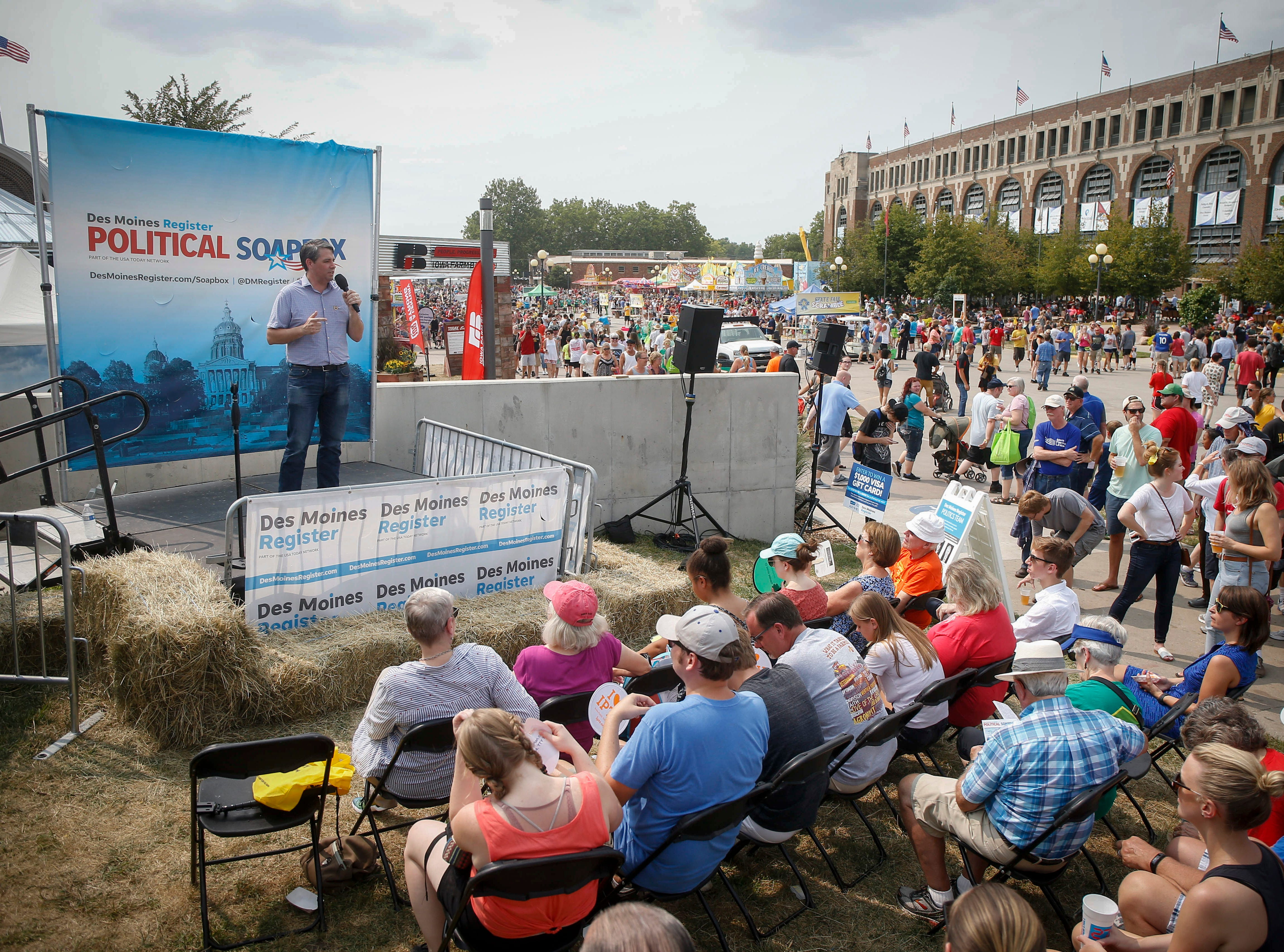 Tim Gannon, Democratic candidate for Iowa Secretary of Agriculture, speaks with supporters during the Political Soapbox on Saturday, Aug. 11, 2018, during the Iowa State Fair in Des Moines.