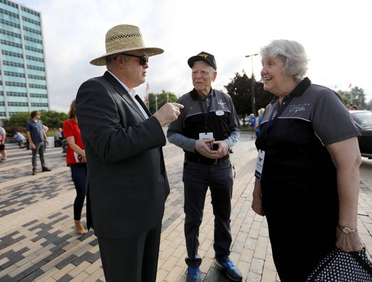 Ford CEO and President James Hackett, left, talks with Tom and Gail Wise of Park Ridge, Illinois about their 1964 Ford Mustang convertible at Ford world headquarters in Dearborn celebrating the building of 10,000,000 Mustangs on Wed., Aug 8, 2018.