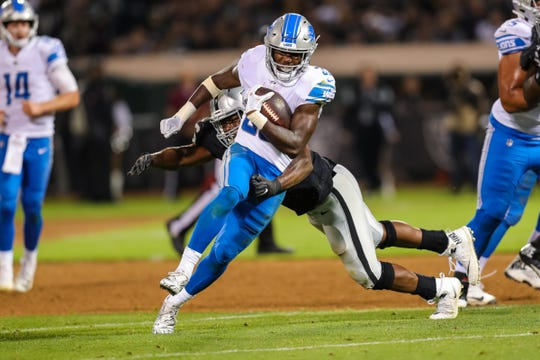 Lions running back Kerryon Johnson runs past an Raiders defender during the third quarter of the 16-10 exhibition loss to the Raiders on Friday, Aug. 10, 2018, in Oakland, Calif.