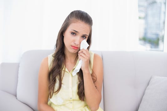 Upset Young Brunette Holding A Tissue