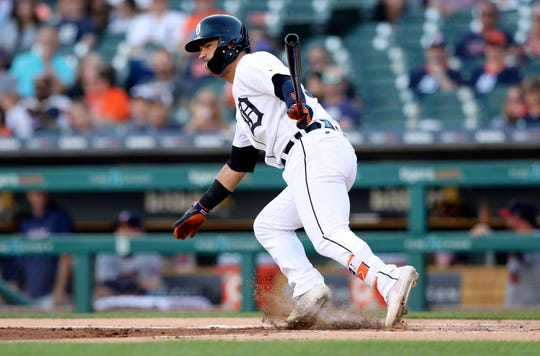 Detroit Tigers' Jose Iglesias hits a single to left field during the first inning of a baseball game against the Minnesota Twins, Friday, Aug. 10, 2018, in Detroit. (AP Photo/Carlos Osorio)