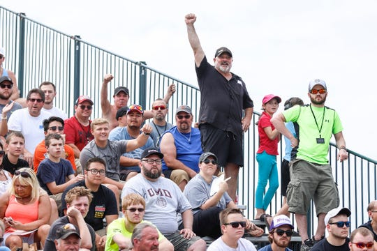 Race car fans cheer during Roadkill Nights Powered by Dodge in Pontiac, Saturday, August 11, 2018.