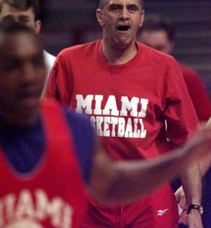 Miami (Ohio) coach Charlie Coles works with his team during practice Thursday, March 13, 1997, at Kemper Arena in Kansas City, Mo., in preparation for Friday's game against Clemson in the NCAA tournament.