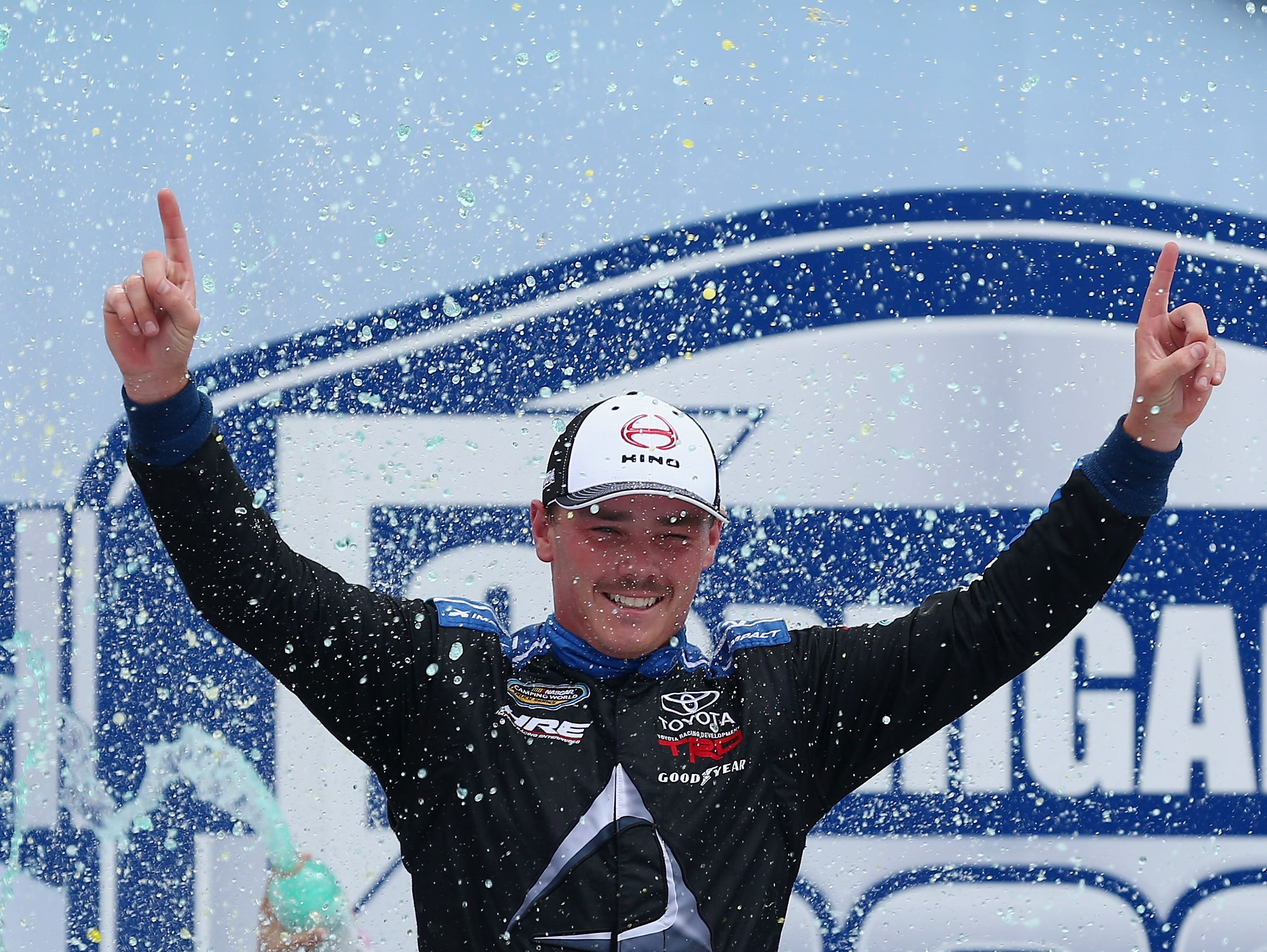Brett Moffitt, driver of the No. 16 Hino Toyota, celebrates in Victory Lane after winning the NASCAR Camping World Truck Series Corrigan Oil 200 at Michigan International Speedway on August 11, 2018 in Brooklyn.