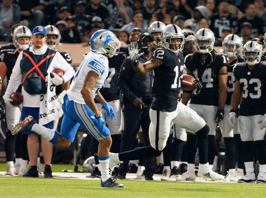 Oakland Raiders wide receiver Martavis Bryant (12) carries the ball against Detroit Lions cornerback Teez Tabor (31) during the first quarter at Oakland Coliseum on Aug. 10, 2018.