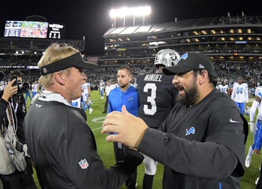 Raiders coach Jon Gruden, left, and Lions coach Matt Patricia shake hands after an exhibition Aug. 10, 2018, in Oakland, Calif.