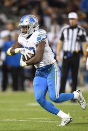 Lions running back Kerryon Johnson carries the ball against the Raiders during the fourth quarter of the 16-10 exhibition loss to the Raiders on Friday, Aug. 10, 2018, in Oakland, Calif.