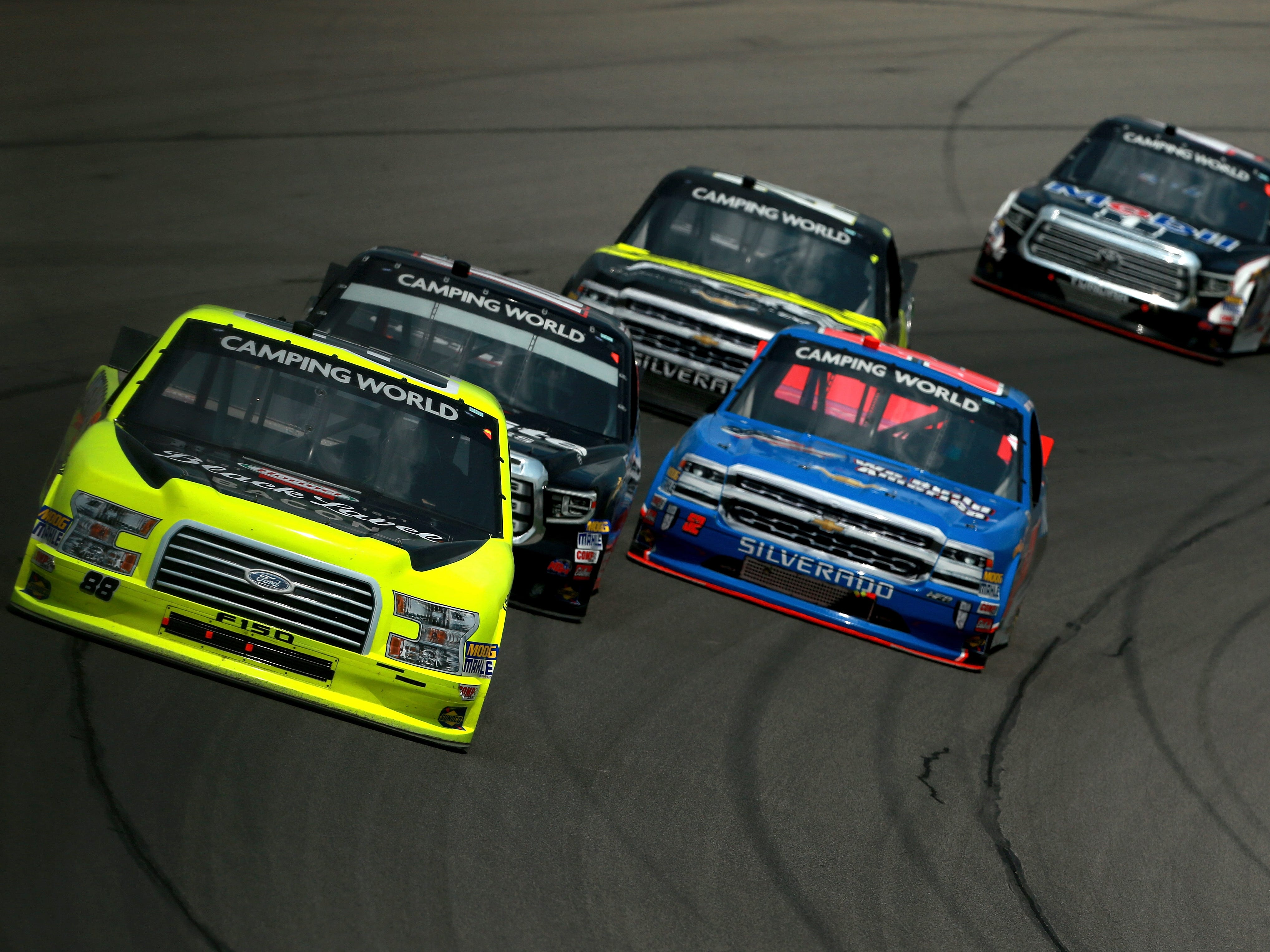 Matt Crafton, driver of the No. 88 Hormel/Menards Ford, leads a pack of trucks during the NASCAR Camping World Truck Series Corrigan Oil 200 at Michigan International Speedway on August 11, 2018 in Brooklyn.