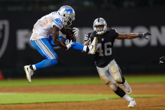 Lions wide receiver Brandon Powell makes a catch against Raiders linebacker Jason Cabinda during the fourth quarter of the 16-10 exhibition loss to the Raiders on Friday, Aug. 10, 2018, in Oakland, Calif.
