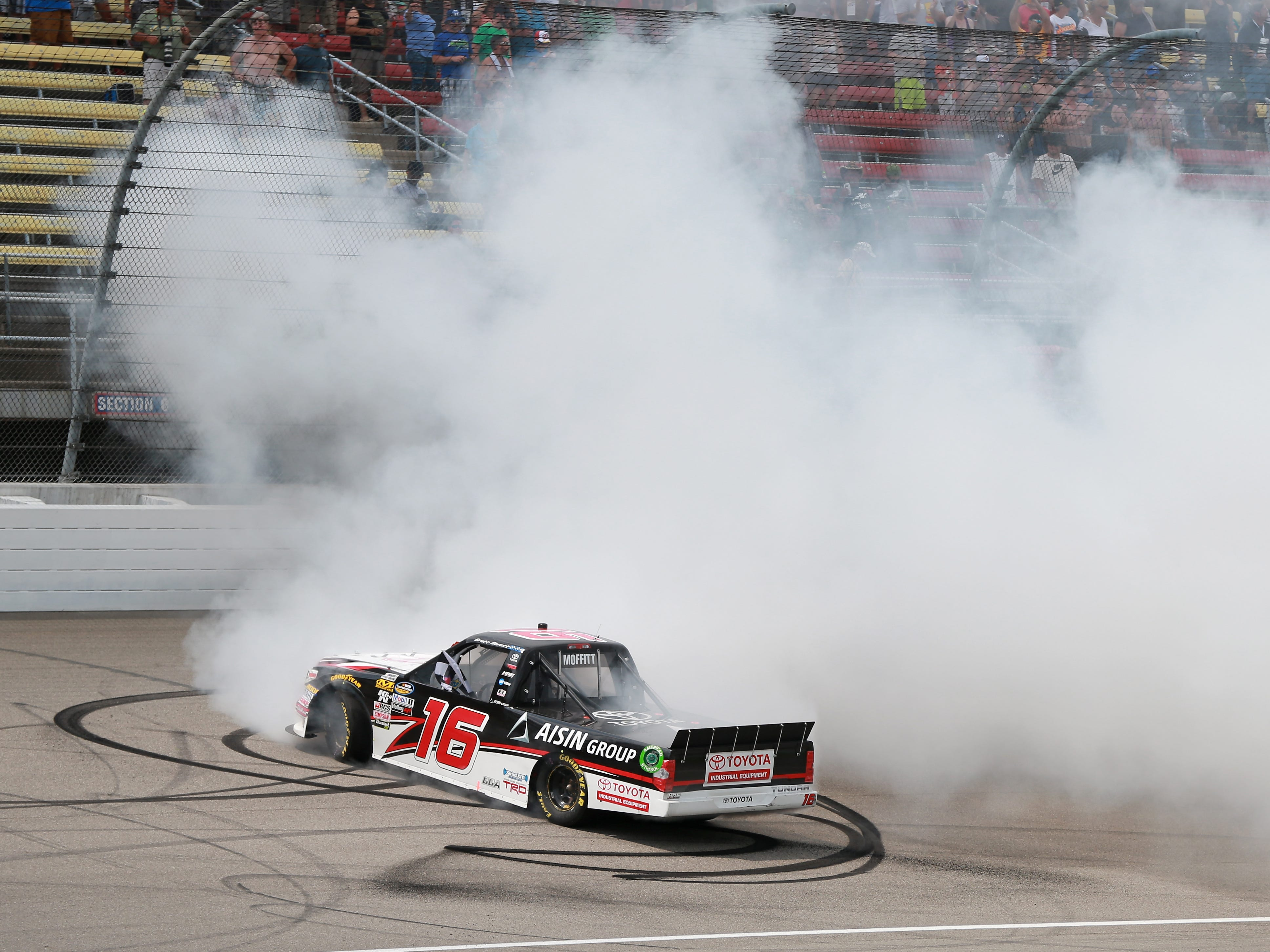 Brett Moffitt, driver of the No. 16 Hino Toyota, celebrates with a burnout after winning the NASCAR Camping World Truck Series Corrigan Oil 200 at Michigan International Speedway on August 11, 2018 in Brooklyn.