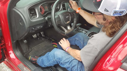 Marc Henretta has equipped his car with hand controls attached to the gas and brake pedals.