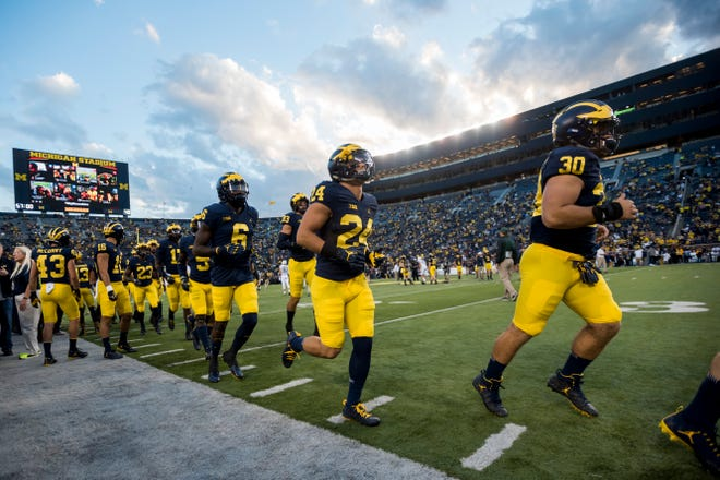 ESPN reported Friday that shoe-marketplace site StockX found 23 pairs of Michigan team-issued shoes on its exchange.