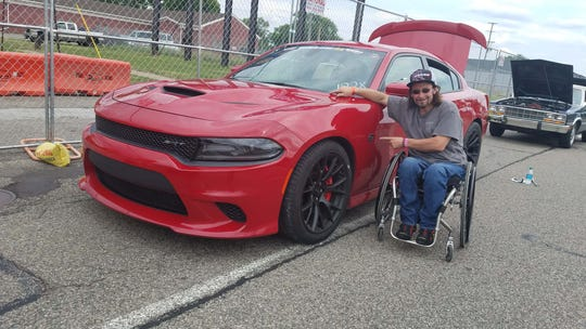 Marc Henretta and his Charger Hellcat during the 2018 Roadkill Nights at M1 Concourse.
