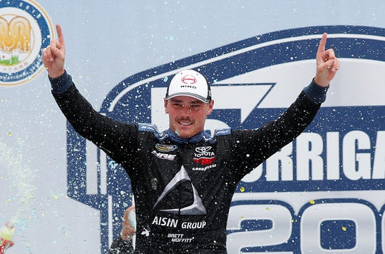 Brett Moffitt celebrates winning a NASCAR truck series race Saturday at Michigan International Speedway in Brooklyn, Mich.