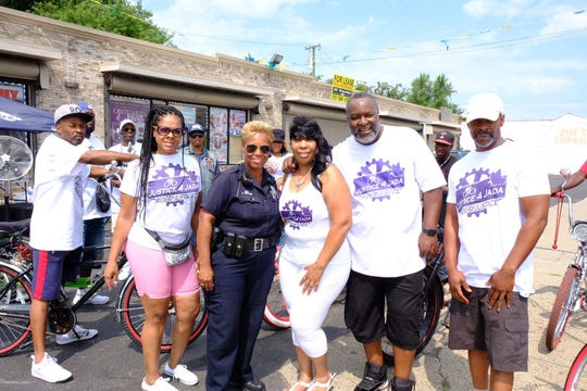 Tawanna Rankin, center, receives support from family members and Detroit police.