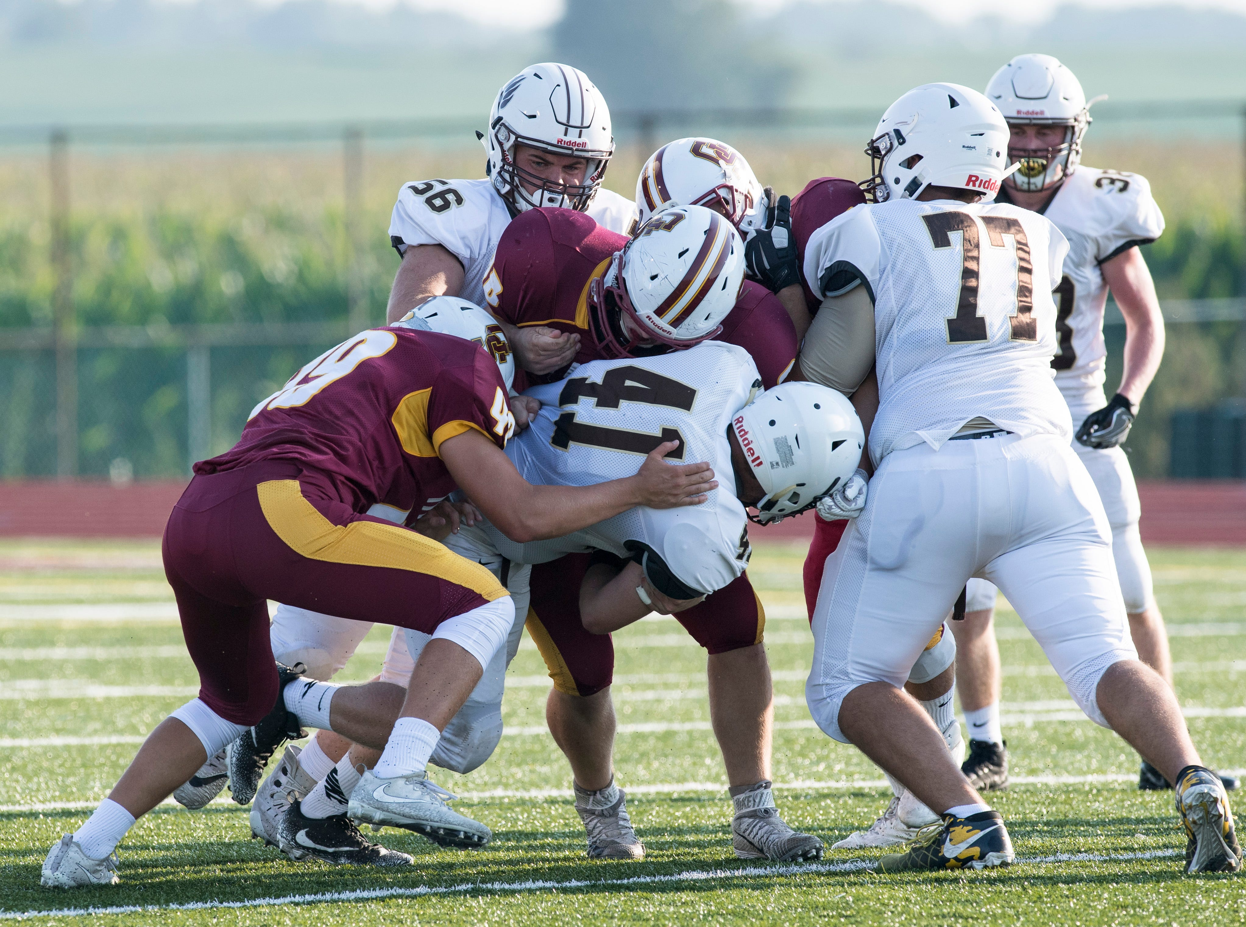 Central's Grant Maas (41) is taken down by Gibson Southern defense during a scrimmage in Fort Branch Friday, August 10, 2018.