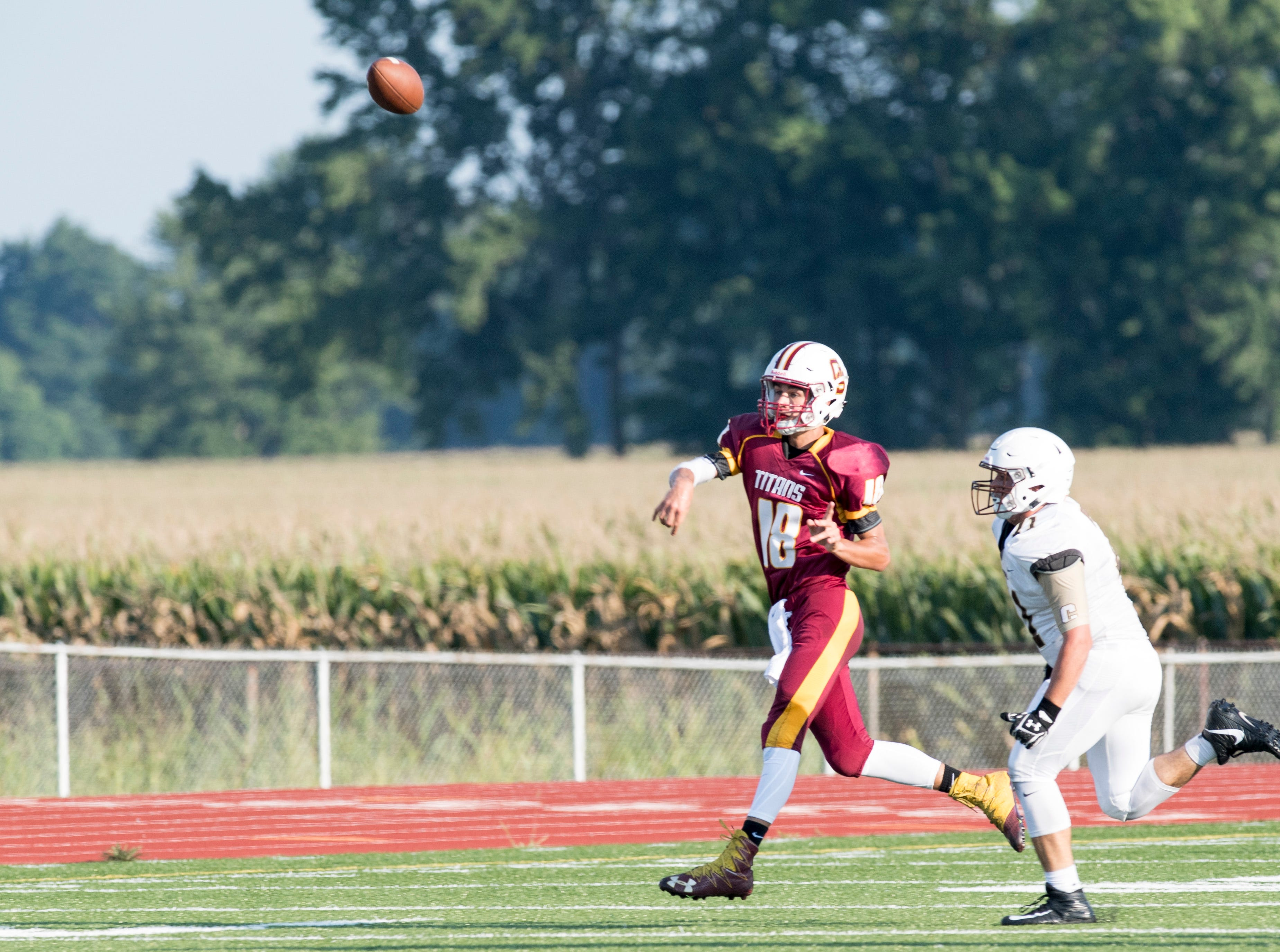 Gibson Southern's Quarterback Brady Allen (18) throws a long pass during a scrimmage against the Evansville Central Bears Friday, August 10, 2018.