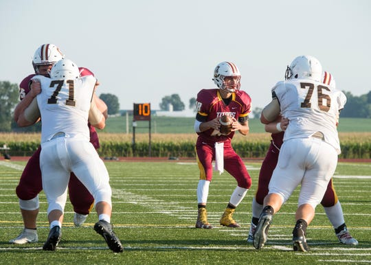 Gibson Southern quarterback Brady Allen (18) looks down field for an open man during a scrimmage against Central.