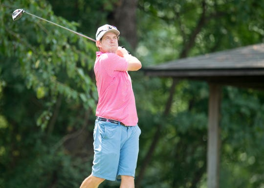Clint Keown tees off on the thirteenth hole during the third round of the Courier & Press Men's City Golf Tournament at Rolling Hills Saturday, August 11, 2018.