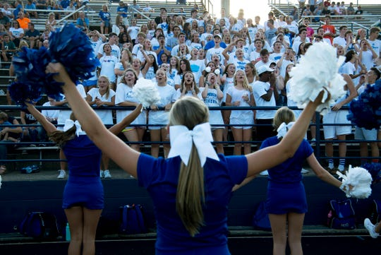 The Memorial student section cheers on their Tigers against the Castle Knights during their scrimmage at John Lidy Field in Paradise, Ind., Friday evening.