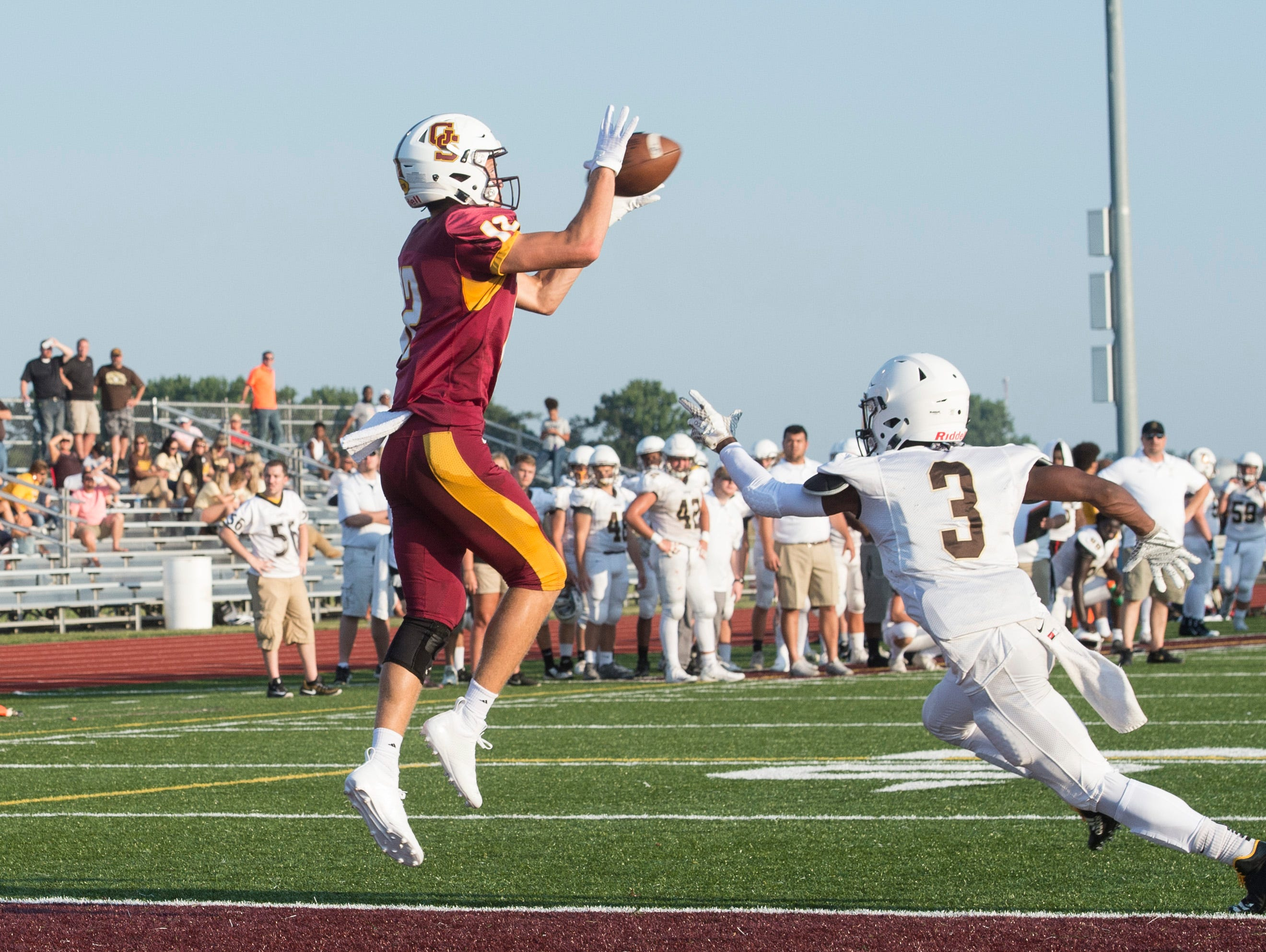 Gibson Southern's Dawson Witte (12) catches the football for a touchdown during a scrimmage against the Evansville Central Bears Friday, August 10, 2018.