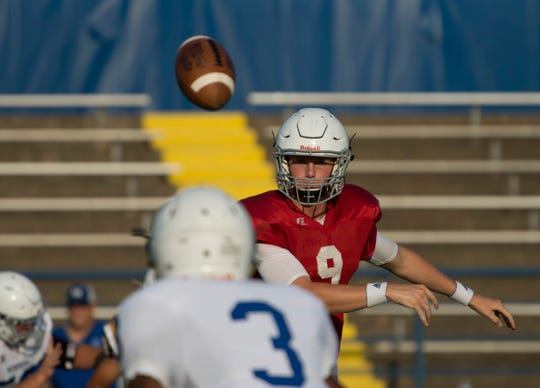 Memorial's Michael Lindauer throws a pass against Castle in their scrimmage last Friday at John Lidy Field.