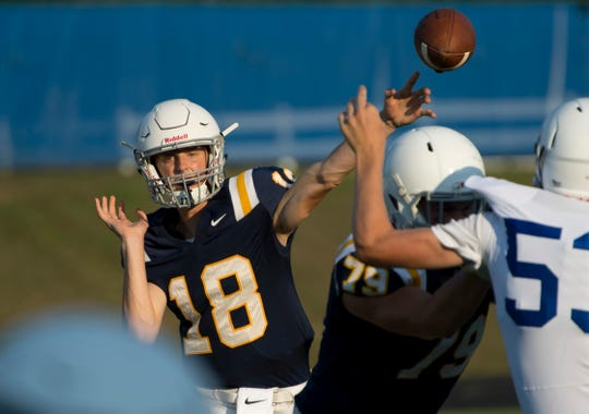 Nathan Harpenau (18) was 9-for-11 for 150 yards in Castle's 42-14 romp over Terre Haute South.