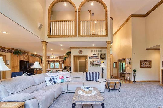 This north side home offers a classical design of more than 6,000 square feet,  plenty of natural surroundings, lake access, a pool, hot tubs and an abundance of storage to go all with all modern amenities.