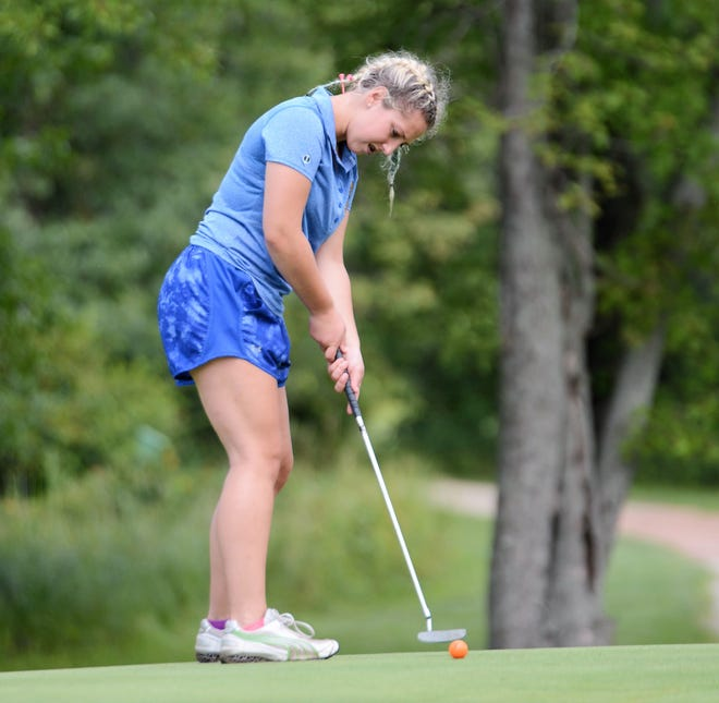 Oconto's Morgan Ratajczyk drains a long put on No. 4 at River Island Golf Course in team scramble with Oconto Falls and Bonduel.
