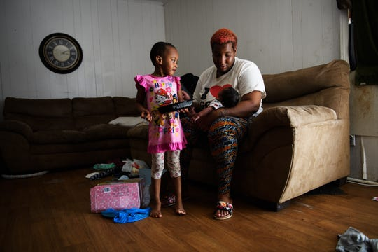 Teonna Williams with her 1-month old son Aben and daughter Na'Zorah, 3, in her apartment on Saturday, Aug. 11, 2018.