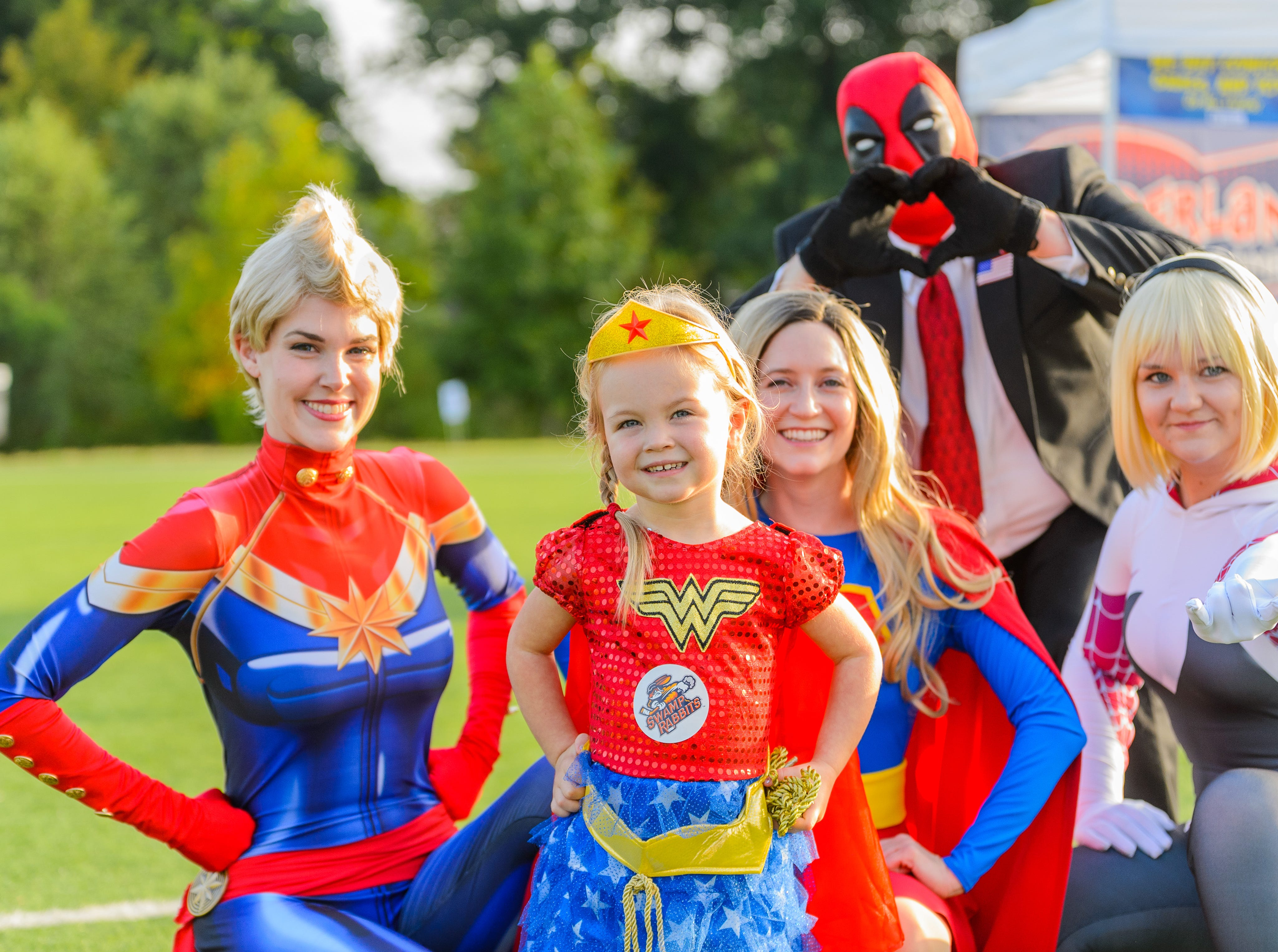2 year old Harper Hunter (front) poses for a picture with volunteers from SC Upstate Heros during the 4th annual Superhero 5K to benefit The Salvation Army Boys & Girls Club is held on Saturday, August 11, 2018 at the Kroc Center in Downtown Greenville.