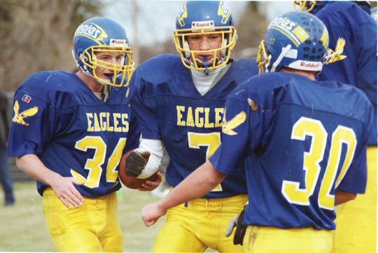 Damen Woolsey (left) celebrates with his Fergus High teammates during a game in 1999