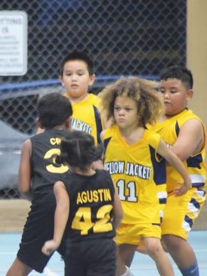 Under-8 action between the Dededo Yellowjackets and Inarajan Hawks One in a Sinajana Youth Basketball League game on Aug. 10 at the Sinajana gym.
