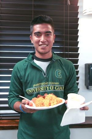 University of Guam dormitory resident Elias David enjoys a meal at the dormitory cafeteria. Starting this semester, students with meal plans will be issued electronic cards to track their 120 meals per semester.