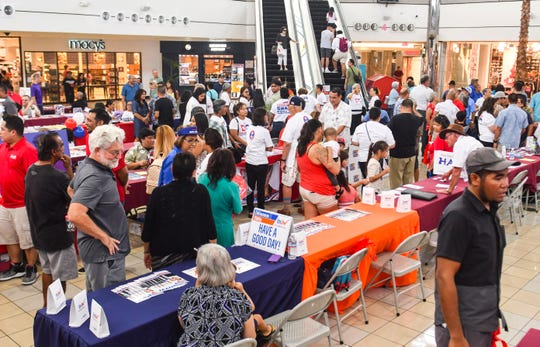 """Constituents meet with incumbent and prospective island leaders during an """"One on One with the Candidates"""" event in the center court of the Micronesia Mall in Dededo on Saturday, Aug. 11, 2018. During the event, reigstered voters and others were afforded the opportunity to meet and talk with candidates, seeking votes for an electorial office position in the upcoming primary election."""