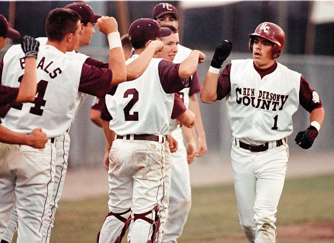 Josh King, a member of the 2018 Henderson County Sports Hall of Fame, is congratulated by his teammates after hitting a leadoff home run against Hopkinsville during the 1999 season.