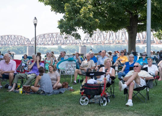 The crowd finds shade under the trees while listening to music during the Bluegrass in the Park and Folklife Festival in Audubon Mill Park Saturday, August 11, 2018.