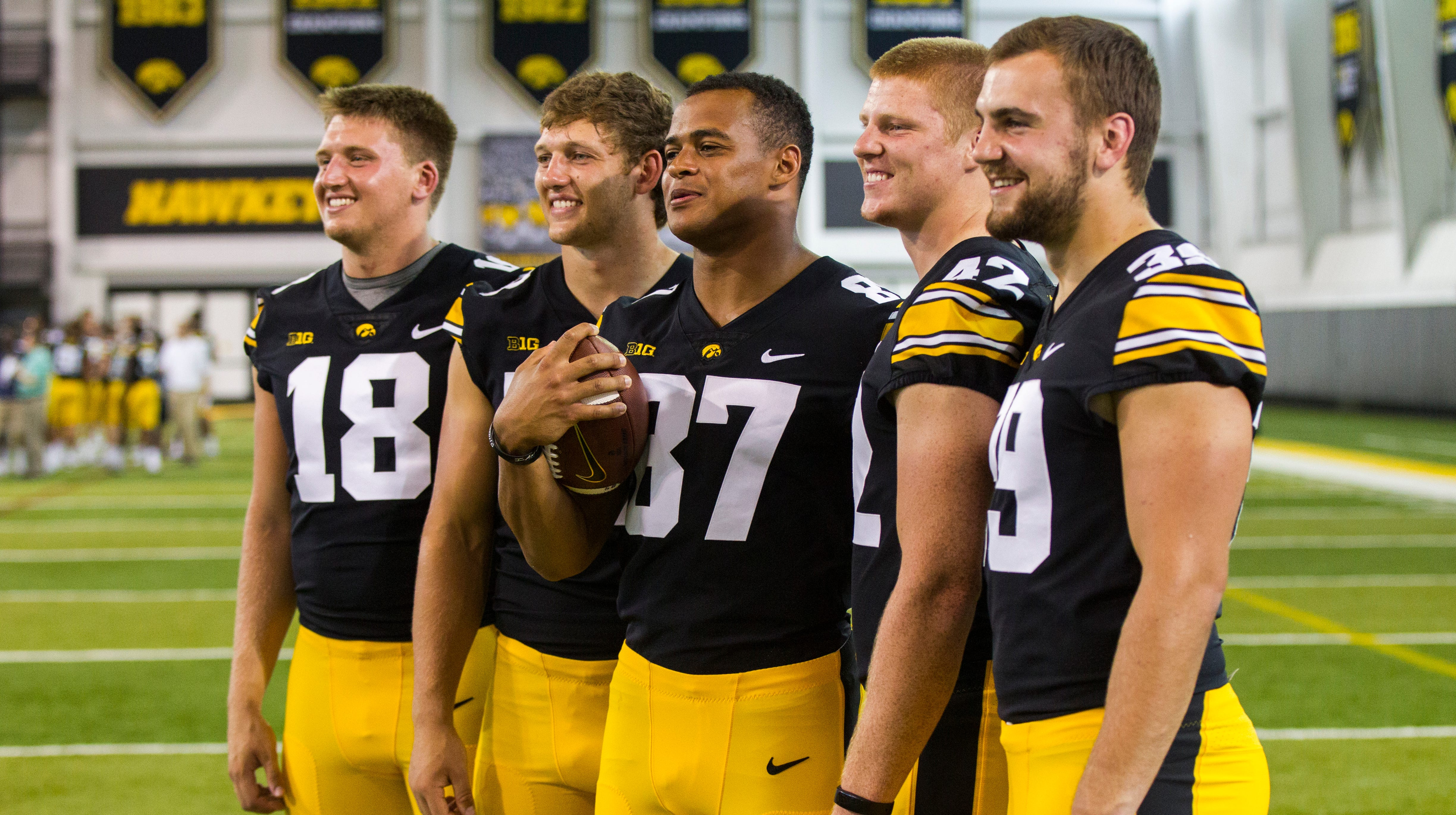 Iowa tight ends Drew Cook, T.J. Hockenson, Noah Fant, Shaun Beyer, and Nate Wieting pose for a photo during Iowa football media day on Friday, Aug. 10, 2018, in Iowa City.
