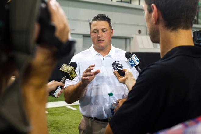 Iowa offensive coordinator Brian Ferentz talks with reporters during Iowa football media day on Friday, Aug. 10, 2018, in Iowa City.