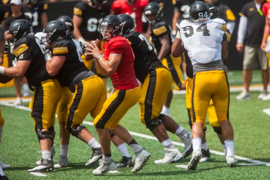 Iowa quarterback Nate Stanley looks to pass during a Kids Day practice on Saturday, Aug. 11, 2018, at Kinnick Stadium in Iowa City.