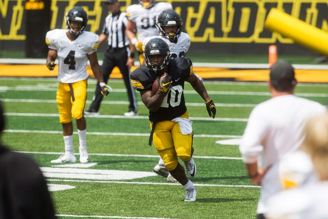 Running back Mekhi Sargent stood out with his shiftiness, power and speed at Iowa's open practice.