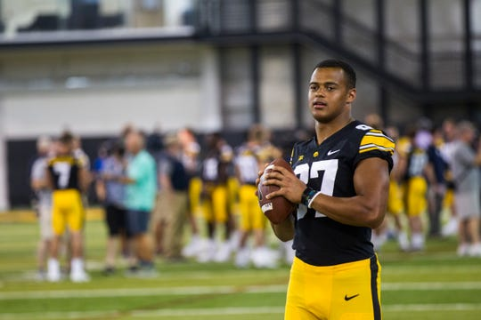 Iowa tight end Noah Fant holds a ball during Iowa football media day on Friday, Aug. 10, 2018, in Iowa City.