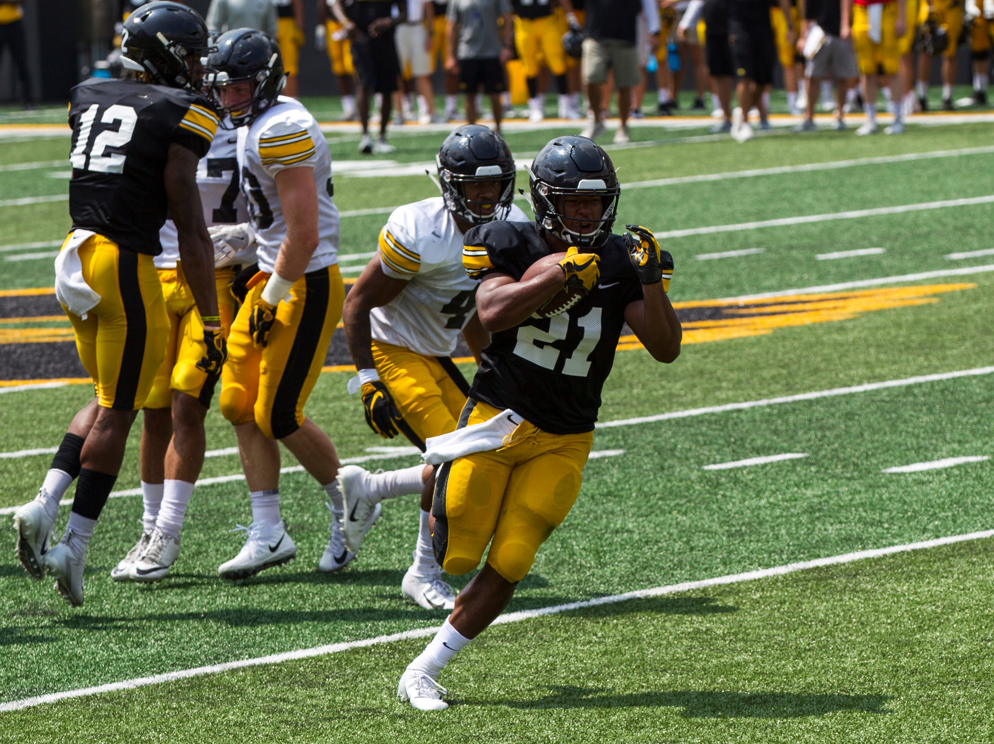 Iowa running back Ivory-Kelly Martin runs the ball during a Kids Day practice on Saturday, Aug. 11, 2018, at Kinnick Stadium in Iowa City.
